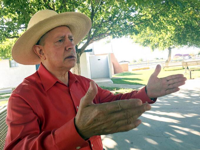 In this Oct. 3, 2018, file photo, Columbus, N.M., Mayor Esequiel Salas talks about how the village is embracing its connection to a violent 1916 raid by Mexican revolutionary Pancho Villa. Residents of this tiny, historic border village are raising concerns about new trailers in the town center meant to house workers building the U.S.-Mexico border wall despite worries over COVID-19. (AP Photo/Russell Contreras, File)