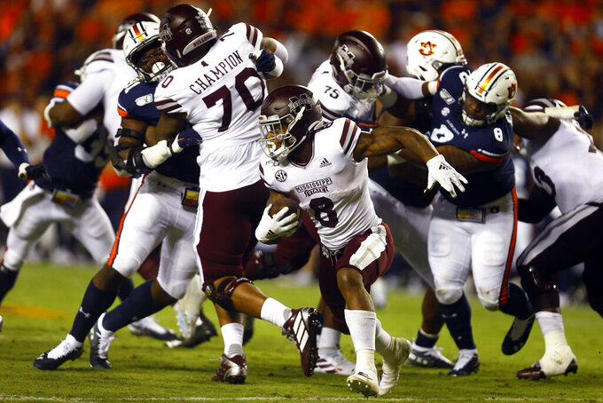 FILE - In this Sept. 28, 2019, file photo, Mississippi State running back Kylin Hill (8) carries the ball during the second half of an NCAA college football game against Auburn, in Auburn, Ala. Mississippi State's lack of a consistent passing attack is starting to hamper star running back Kylin Hill as opposing defenses focus on stopping the ground game. After rushing for over 100 yards in each of his first four games this year, Hill has been held below 50 yards in each of Mississippi State's last two games. Next up is No. 2 LSU (6-0, 2-0 SEC), which has the SEC's second-ranked run defense. (AP Photo/Butch Dill, File)