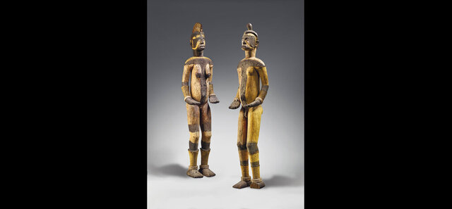 In this undated photo issued by Christie's auction house, two Igbo statues on display. The pair of sacred statues, that a Nigerian museum commission and protesters claimed were looted during the country's 1960s civil war fetched 212,500 euros ($239,000) at auction in Paris on Monday, June 29, 2020. Christie's auction house, which defended the sale and said the artworks were legitimately acquired. (Christie's via AP)