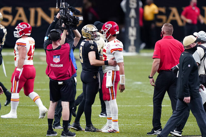 New Orleans Saints quarterback Drew Brees (9) greets Kansas City Chiefs quarterback Patrick Mahomes (15) after an NFL football game in New Orleans, Sunday, Dec. 20, 2020. The Chiefs won 32-29. (AP Photo/Butch Dill)