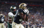 Colorado tight end Jalen Harris, front, pulls in a pass for a touchdown as Colorado State safety Jamal Hicks defends in the first quarter of an NCAA college football game Friday, Aug. 30, 2019, in Denver. (AP Photo/David Zalubowski)