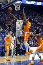 Kentucky's Tyrese Maxey (3) shoots while defended by Tennessee's Josiah-Jordan James (5) during the second half of an NCAA college basketball game Tuesday, March 3, 2020, in Lexington, Ky. Tennessee won 81-73. (AP Photo/James Crisp)