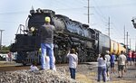 """FILE - In this Aug. 12, 2021, file photo, Union Pacific steam locomotive Big Boy No. 4014 leaves Vinita, Okla. Cheyenne-based Big Boy No. 4014 returns home Tuesday, Sept. 7, 2021, from a month long tour of the nation. Led by Ed Dickens, the Union Pacific Heritage Steam program's showpiece is the massive locomotive that concluded its restoration in 2019 with a tour that marked the 150th anniversary of the completion of the Transcontinental Railroad, which became known as the """"overland route"""" which linked the nation. (Mike Simons/Tulsa World via AP, File)"""