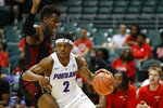 Portland guard JoJo Walker (2) tries to get past Houston forward Fabian White Jr. (35) during the first half of the NCAA college basketball game Sunday, Dec. 22, 2019, in Honolulu. (AP Photo/Marco Garcia)