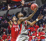 Mississippi guard Luis Rodriguez (15) scores next to Seattle guard Delante Jones (24) during an NCAA college basketball game Tuesday, Nov. 19, 2019, in Oxford, Miss. (Bruce Newman/The Oxford Eagle via AP)