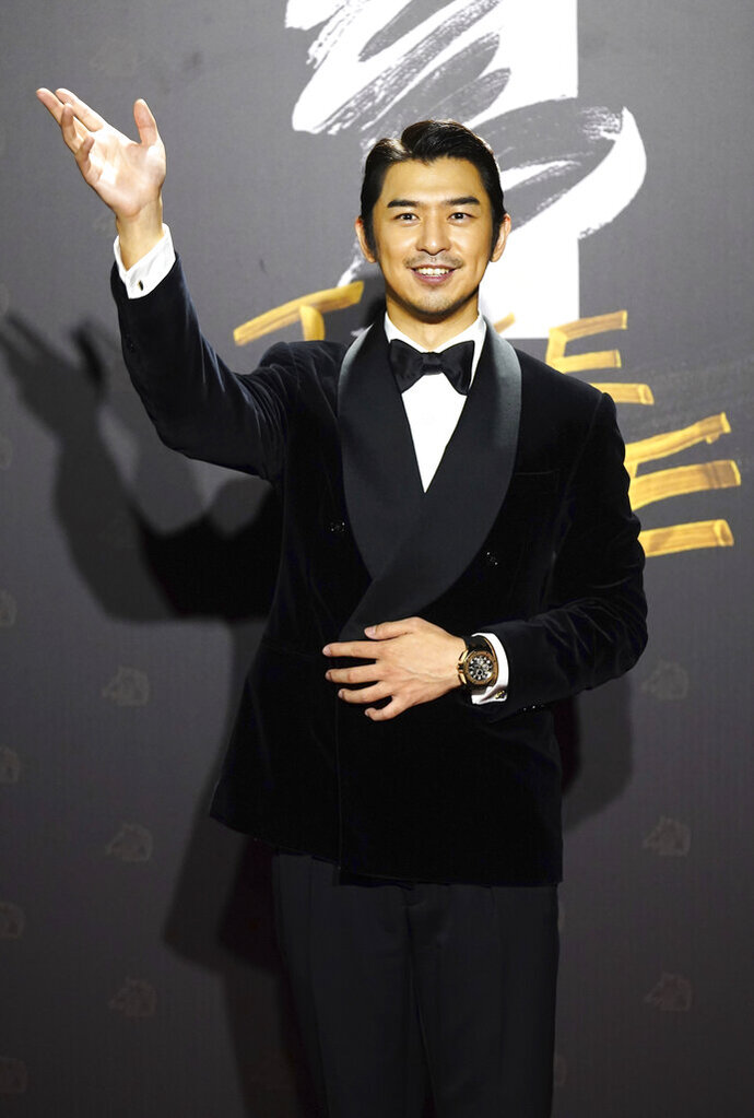 Taiwanese actor Bo-Lin Chen arrives at the 57th Golden Horse Awards in Taipei, Taiwan, Saturday, Nov. 21, 2020. Chen is guest at this year's Golden Horse Awards, one of the Chinese-language film industry's biggest annual events. (AP Photo/Billy Dai)
