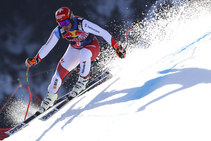 Switzerland's Beat Feuz speeds down the course during an alpine ski, men's World Cup downhill in Kitzbühel, Austria, Friday, Jan. 22, 2021. (AP Photo/Marco Trovati)