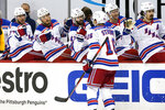 New York Rangers' Ryan Strome (16) returns to the bench after scoring during the second period of an NHL hockey game against the Pittsburgh Penguins in Pittsburgh, Sunday, Jan. 24, 2021. (AP Photo/Gene J. Puskar)