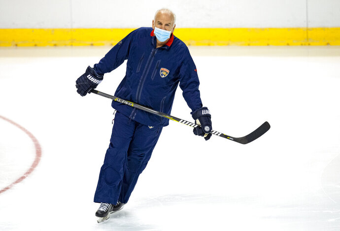 Florida Panthers head coach Joel Quenneville skates during the first practice of training camp in preparation for the 2020-21 NHL season at the BB&T Center on Monday, Jan.  4, 2021 in Sunrise. (David Santiago/Miami Herald via AP)