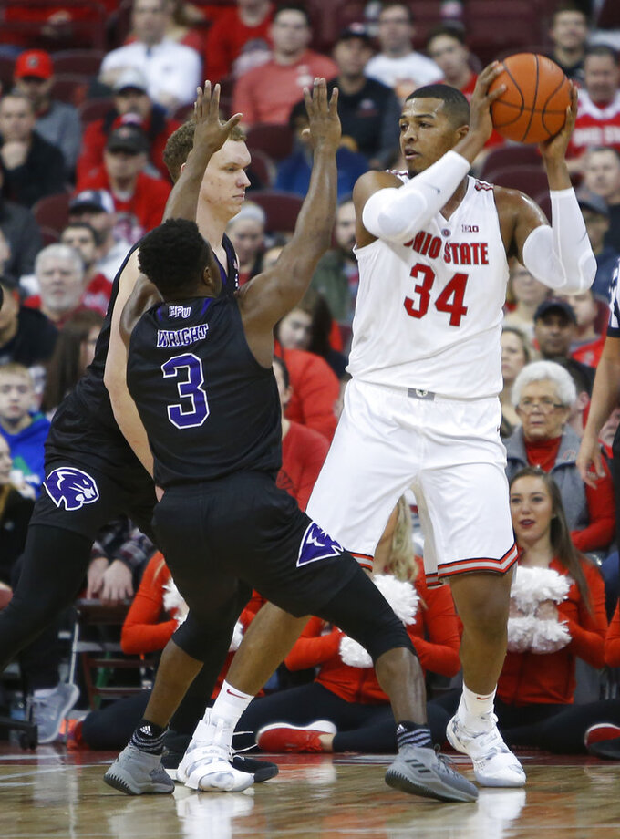 Ohio State's Kaleb Wesson, right, posts up against High Point's Sam Berlin, left, and Jamal Wright during the first half of an NCAA college basketball game Saturday, Dec. 29, 2018, in Columbus, Ohio. (AP Photo/Jay LaPrete)