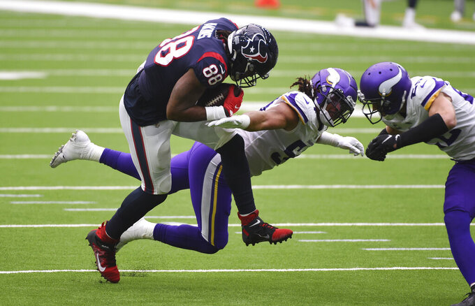 Houston Texans tight end Jordan Akins (88) makes a catch over Minnesota Vikings middle linebacker Eric Kendricks (54) during the first half of an NFL football game Sunday, Oct. 4, 2020, in Houston. (AP Photo/Eric Christian Smith)