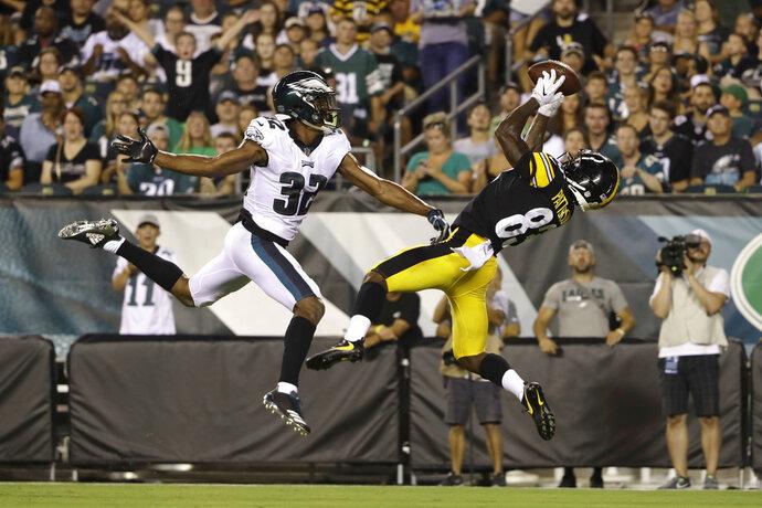 Pittsburgh Steelers' Damoun Patterson, right, catches a touchdown pass next to Philadelphia Eagles' Rasul Douglas during the first half of a preseason NFL football game Thursday, Aug. 9, 2018, in Philadelphia. (AP Photo/Matt Rourke)