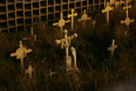 Crosses stand on El Tejar cemetery's potters field in Quito, Ecuador, Wednesday, Sept. 11, 2019. Many tourists said they found the night visit to the cemetery to be a nearly meditative experience. (AP Photo/Dolores Ochoa)
