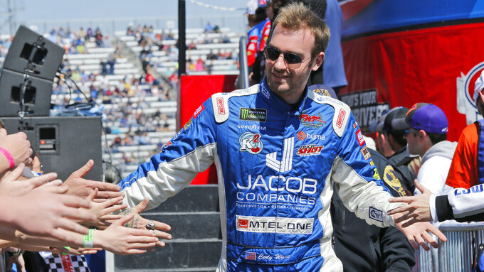 NASCAR Cup Series driver Cody Ware (51) greets fans during driver introductions prior to the NASCAR Cup Series auto race at the Martinsville Speedway in Martinsville, Va., Sunday, March 24, 2019. (AP Photo/Steve Helber)