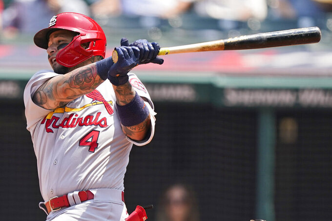 St. Louis Cardinals' Yadier Molina hits an RBI-single in the first inning of a baseball game against the Cleveland Indians, Wednesday, July 28, 2021, in Cleveland. (AP Photo/Tony Dejak)