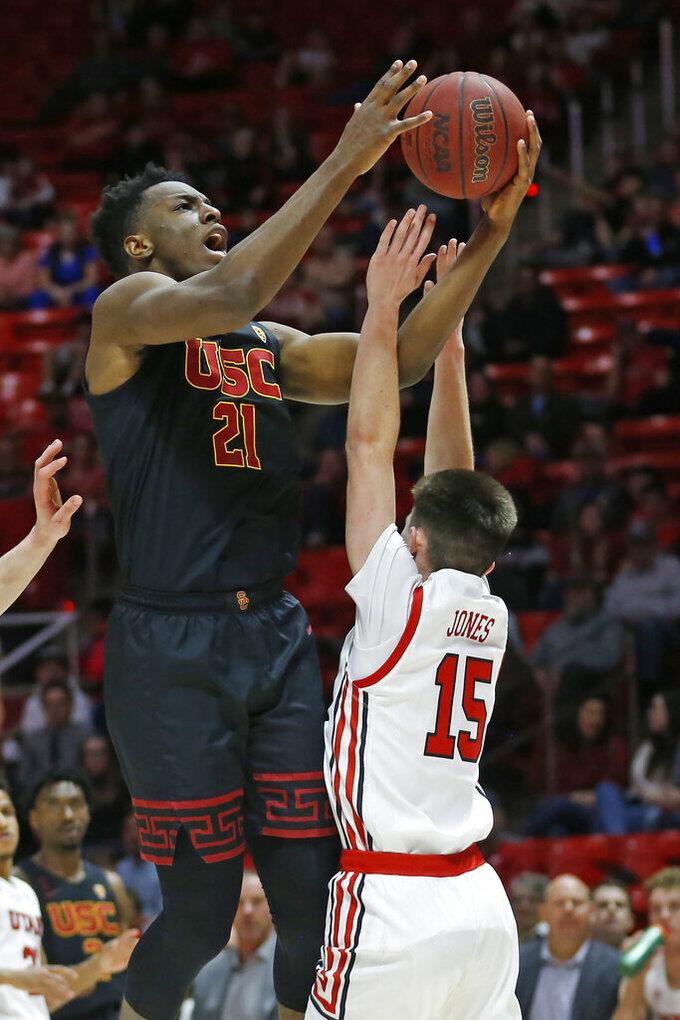 USC forward Onyeka Okongwu (21) goes to the basket as Utah guard Rylan Jones (15) defends in the first half of an NCAA college basketball game Sunday, Feb. 23, 2020, in Salt Lake City. (AP Photo/Rick Bowmer)