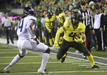 Oregon's Mycah Pittman, right, looks for extra yards against Arizona's Christian Roland-Wallace, left, after a pass reception during the first half of an NCAA college football game Saturday, Nov. 16, 2019, in Eugene, Ore. (AP Photo/Chris Pietsch)