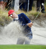 USA's Justin Thomas hits out of a bunker during a practice session ahead of the President's Cup Golf tournament in Melbourne, Tuesday, Dec. 10, 2019. (AP Photo/Andy Brownbill)