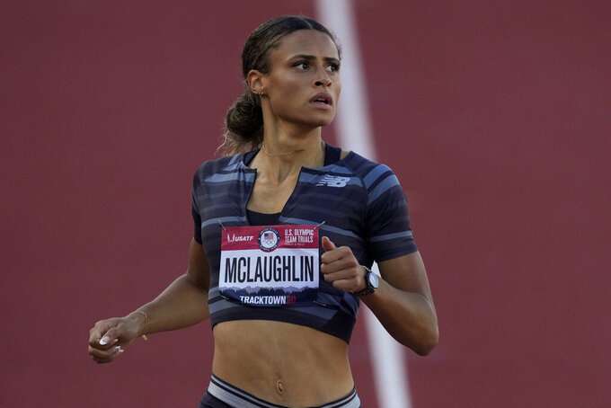 Sydney McLaughlin wins a semi-final in the women's 400-meter hurdles at the U.S. Olympic Track and Field Trials Saturday, June 26, 2021, in Eugene, Ore. (AP Photo/Ashley Landis)