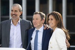 Peloton CEO John Foley, center, stands with President William Lynch, left, and Chief Financial Officer Jill Woodward during the company's IPO at the Nasdaq MarketSite, Thursday, Sept. 26, 2019, in New York. (AP Photo/Mark Lennihan)