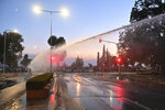 Greek police use a water cannon to disperse anti-vaccine protesters during a rally, at the northern city of Thessaloniki, Greece, Saturday, Sept. 11, 2021. While Greece's Prime Minister, Konstantinos Mitsotakis was touting the achievements of his government despite the pandemic emergency, some 3,500 vaccination deniers clashed with riot police near the venue. (AP/Photo Giannis Papanikos)