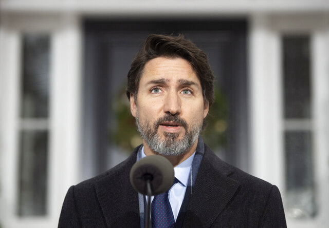 Canadian Prime Minister Justin Trudeau speaks at a bi-weekly news conference outside Rideau cottage on the COVID-19 pandemic in Ottawa, Ontario, Friday, Nov. 27, 2020. (Adrian Wyld/The Canadian Press via AP)