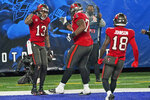 Tampa Bay Buccaneers' Mike Evans, left, celebrates his touchdown with teammates during the second half of an NFL football game against the New York Giants, Monday, Nov. 2, 2020, in East Rutherford, N.J. (AP Photo/Corey Sipkin)