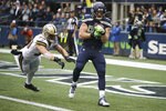 Seattle Seahawks' Will Dissly, right, catches the ball for a touchdown as New Orleans Saints' A.J. Klein defends during the second half of an NFL football game, Sunday, Sept. 22, 2019, in Seattle. (AP Photo/Scott Eklund)