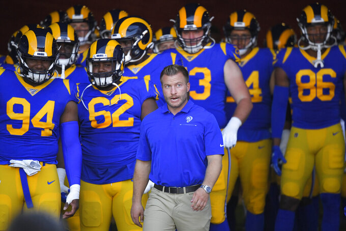 Los Angeles Rams head coach Sean McVay enters the field with his team before the start of an NFL preseason football game against the Denver Broncos Saturday, Aug. 24, 2019, in Los Angeles. (AP Photo/Mark J. Terrill)