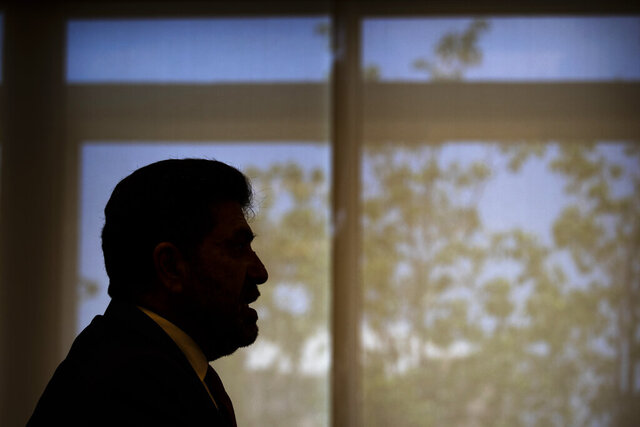 Lebanese Energy Minister Raymond Ghajar speaks during an interview in Beirut, Lebanon, Thursday, July 16, 2020. Lebanon's worsening economic crisis which culminated with the tiny nation defaulting on its debt this year is making it increasingly difficult to attract investors to the country's ailing electricity sector, which has been a huge drain on state coffers for decades, Ghajar said. (AP Photo/Hassan Ammar)