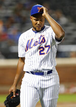 New York Mets relief pitcher Jeurys Familia (27) removes his cap aas he leaves the mound after walking in the go-ahead run on a bases-loaded walk in the eighth inning of a baseball game against the Washington Nationals, Monday, April 16, 2018, in New York. (AP Photo/Kathy Willens)