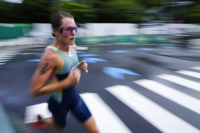 Flora Duffy, of Bermuda, runs during the women's triathlon competition at the 2020 Summer Olympics Tuesday, July 27, 2021, in Tokyo, Japan. (AP Photo/Eugene Hoshiko)