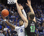 Kentucky's Ashton Hagans (0) shoots under pressure from Utah Valley's Brandon Morley (13) during the second half of an NCAA college basketball game in Lexington, Ky., Monday, Nov. 18, 2019. Kentucky won 82-74. (AP Photo/James Crisp)