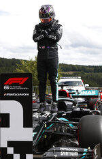 Mercedes driver Lewis Hamilton of Britain reacts after placing first in the qualifying session prior to the Formula One Grand Prix at the Spa-Francorchamps racetrack in Spa, Belgium Saturday, Aug. 29, 2020. Hamilton will start in pole position for the race on Sunday. (Francois Lenoir, Pool via AP)