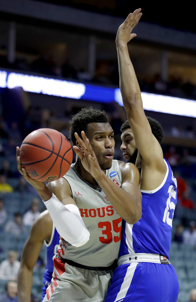 Houston's Fabian White Jr. (35) looks to pass around Georgia State's D'Marcus Simonds (15) during the first half of a first round men's college basketball game in the NCAA Tournament Friday, March 22, 2019, in Tulsa, Okla. (AP Photo/Charlie Riedel)