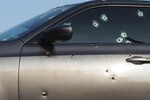 A gray car with multiple bullet holes was involved in a fatal shooting on Monday, Sept. 21, 2020, in Kansas City. Authorities have identified a child killed in a triple shooting in Kansas City as a 1-year-old boy, making him the city's youngest homicide victim this year, police said. Tyron Payton was in the back seat of a car with three other adults when someone opened fire on their vehicle Monday afternoon, police said. (Shelly Yang/The Kansas City Star via AP)