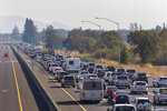 Traffic is backed up heading South on Highway 101 during mandatory evacuations due to predicted danger from the Kincade Fire, in Windsor, Calif., on Saturday, Oct. 26, 2019. The entire communities of Healdsburg and Windsor were ordered to evacuate ahead of strong winds that could lead to erratic fire behavior near the blaze burning in wine country. (Darryl Bush/The Press Democrat via AP)