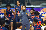 Morgan State head coach, Kevin Broadus signals for his players after calling a time-out during the second half of an NCAA college basketball game against Norfolk State in the championship of the Mid-Eastern Athletic Conference tournament at the Scope Arena on Saturday, March 13, 2021, in Norfolk, Va. (AP Photo/Mike Caudill)