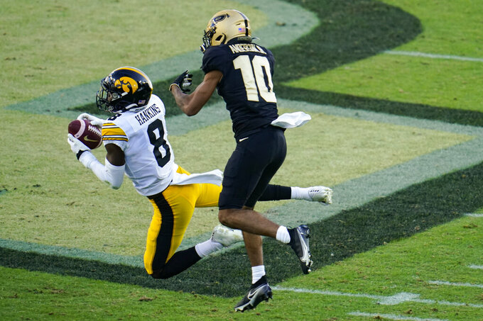 Iowa defensive back Matt Hankins (8) intercepts a pass in front of Purdue wide receiver Amad Anderson Jr. (10) during the second quarter of an NCAA college football game in West Lafayette, Ind., Saturday, Oct. 24, 2020. (AP Photo/Michael Conroy)