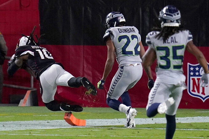 Arizona Cardinals wide receiver DeAndre Hopkins (10) scores a touchdown as Seattle Seahawks cornerback Quinton Dunbar (22) defends during the first half of an NFL football game, Sunday, Oct. 25, 2020, in Glendale, Ariz. (AP Photo/Ross D. Franklin)
