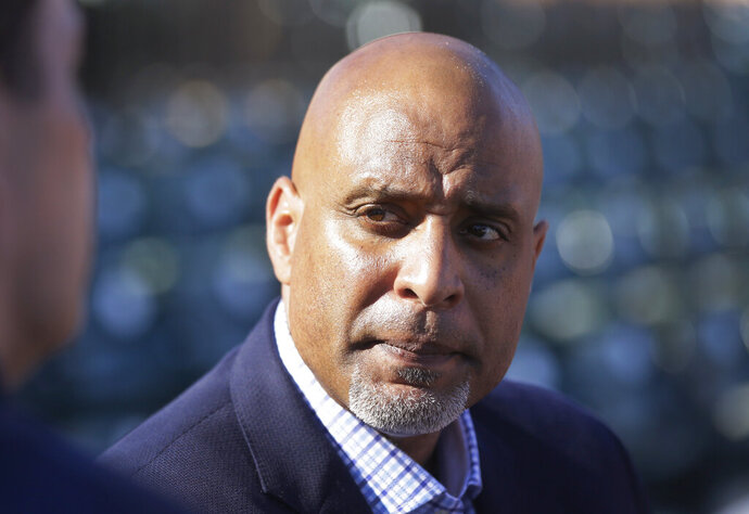 FILE - In this March 17, 2015, file photo, Tony Clark, executive director of the baseball players' union, talks to reporters before a spring training baseball game between the Detroit Tigers and the Washington Nationals in Lakeland, Fla.  Players who test positive for opioids would enter treatment and not be suspended under the change to Major League Baseball's drug agreement being negotiated by management and the players' association, according to union head Tony Clark. (AP Photo/Carlos Osorio, File)