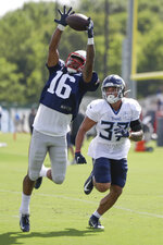 New England Patriots wide receiver Jakobi Meyers (16) reaches for a pass as he is defended by Tennessee Titans defensive back Amani Hooker (37) during a combined NFL football training camp Wednesday, Aug. 14, 2019, in Nashville, Tenn. (AP Photo/Mark Humphrey)