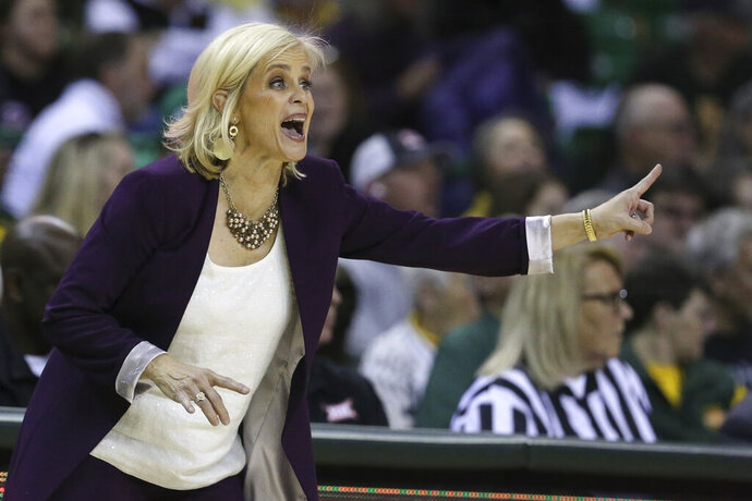Baylor head coach Kim Mulkey calls in an offensive play in the second half of an NCAA college basketball game against West Virginia, Saturday, Jan. 18, 2020, in Waco, Texas. (AP Photo/Rod Aydelotte)