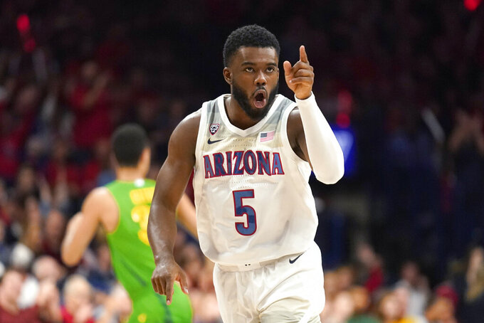 Arizona guard Max Hazzard (5) reacts after scoring a basket against Oregon during the first half of an NCAA college basketball game Saturday, Feb. 22, 2020, in Tucson, Ariz. (AP Photo/Rick Scuteri)