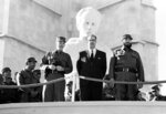 FILE - In this Jan. 2, 1966 file photo, Cuban Prime Minister Fidel Castro, right, President Osvaldo Dorticos, center, and Armed Forces Chief, Commander Raul Castro, watch a military parade commemorating the 7th anniversary of the Cuban Revolution in Havana, Cuba. Dorticos, who was named Cuba's president in 1959, resigned in 1976. Fidel officially became Cuba's president and established a successor role of first vice president for his younger brother Raul. (AP Photo/File)