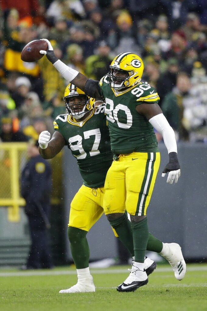 Green Bay Packers' Montravius Adams reacts after re recovering a fumble during the first half of an NFL football game against the Carolina Panthers Sunday, Nov. 10, 2019, in Green Bay, Wis. (AP Photo/Jeffrey Phelps)