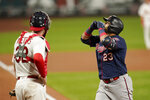 Minnesota Twins' Nelson Cruz (23) celebrates after hitting a solo home run during the seventh inning as St. Louis Cardinals catcher Matt Wieters watches in the second game of a baseball doubleheader Tuesday, Sept. 8, 2020, in St. Louis. (AP Photo/Jeff Roberson)