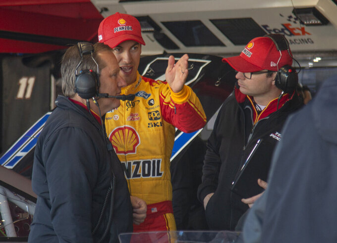 Joey Logano talks with crew members during practice for the NASCAR Monster Energy Cup Series race at Martinsville Speedway in Martinsville, Va., Saturday, March 23, 2019. (AP Photo/Matt Bell)