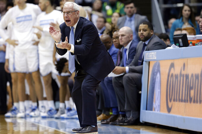 North Carolina head coach Roy Williams yells during the second half of an NCAA college basketball game against Pittsburgh in Chapel Hill, N.C., Wednesday, Jan. 8, 2020. (AP Photo/Gerry Broome)