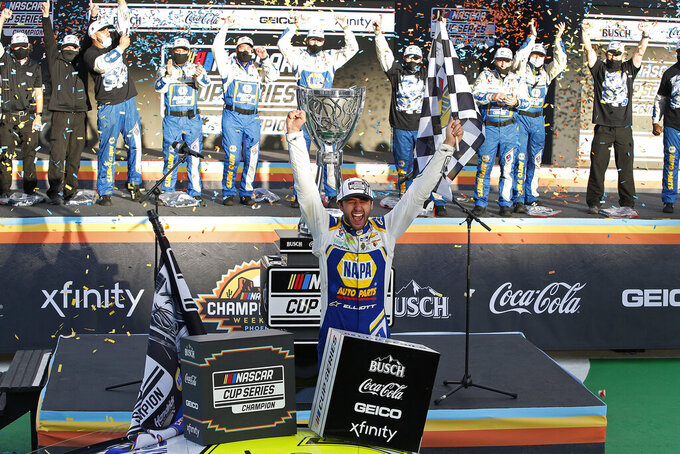 Chase Elliott celebrates his season championship in Victory Lane after winning the NASCAR Cup Series auto race at Phoenix Raceway, Sunday, Nov. 8, 2020, in Avondale, Ariz. (AP Photo/Ralph Freso)